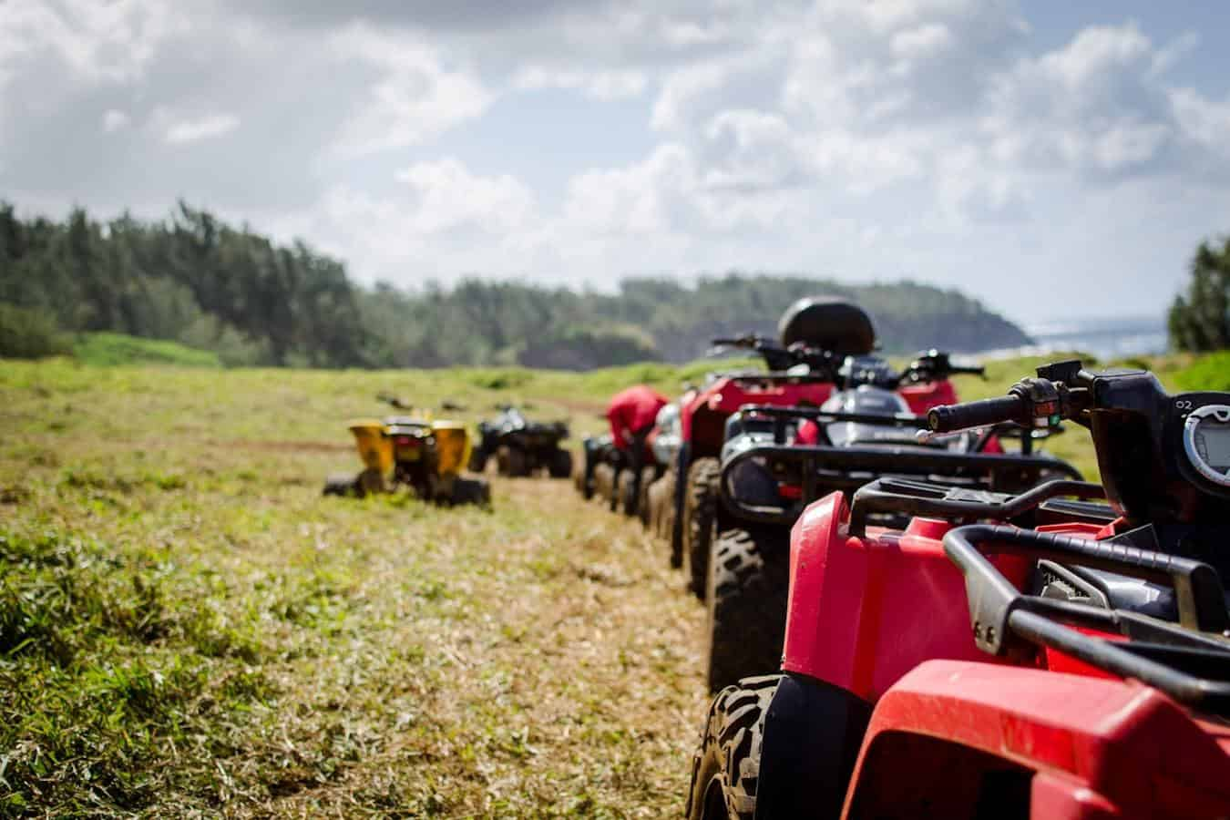 ATVs in a row in a field