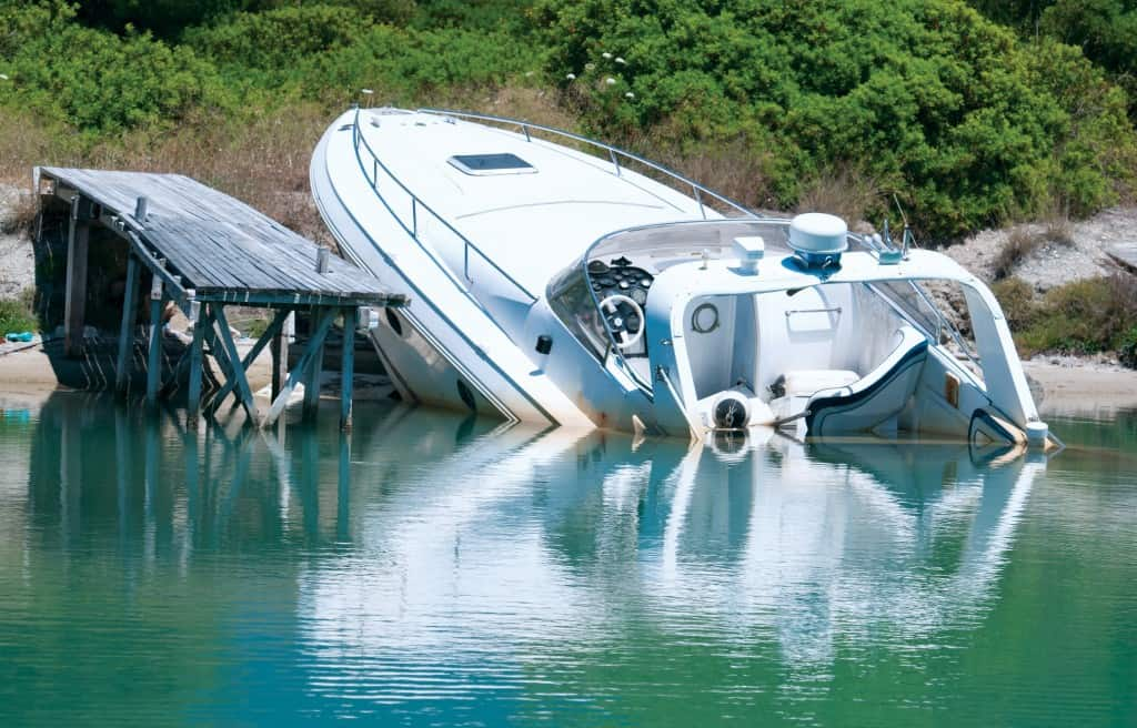 Sinking boat at a dock