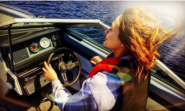 Woman driving a boat