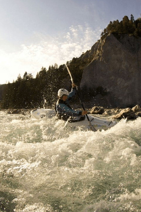 Person paddling in white water rapids