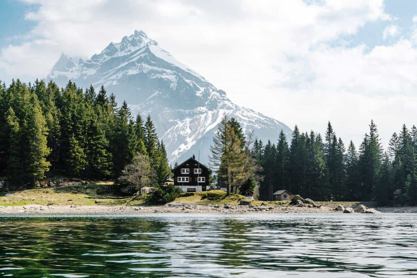 Cottage on a lake with mountain in back