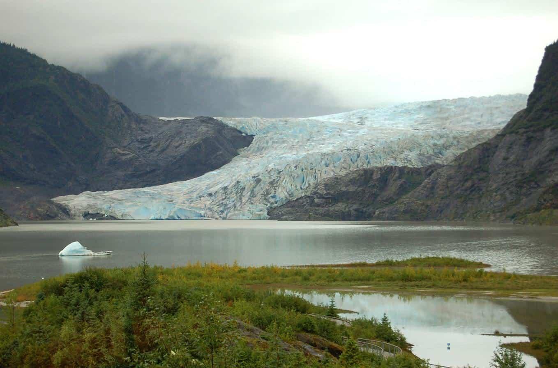 Glacier feeding into small lake in Alaska.