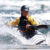 Campfire Collective Kayaking Ambassador Amber Champion shooting whitewater rapids in her kayak.