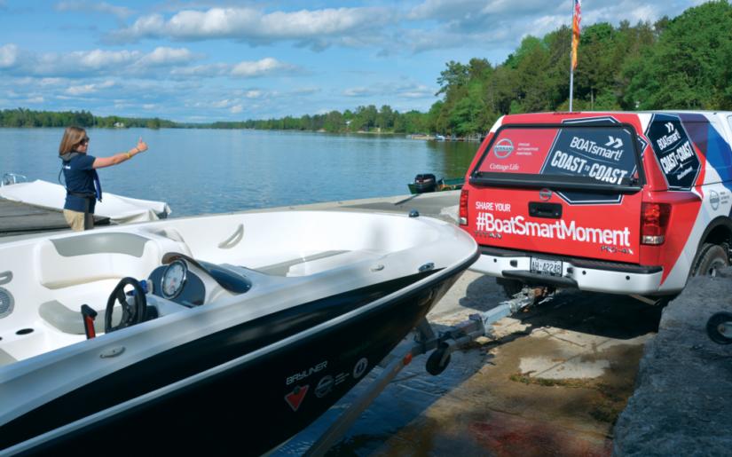 BOATsmart! Nissan Titan backing up Bayliner boat down boatlaunch ramp.