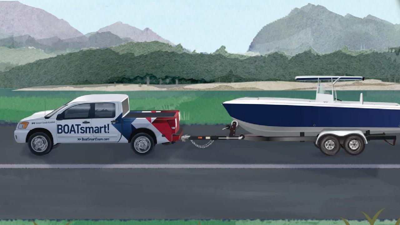 BOATsmart! Nissan Titan towing boat on trailer. Illustration.