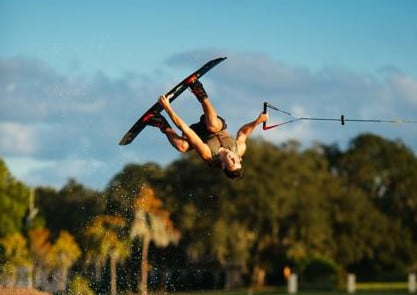 Campfire Collective Ambassador Billy Allen performing trick on his wakeboard.
