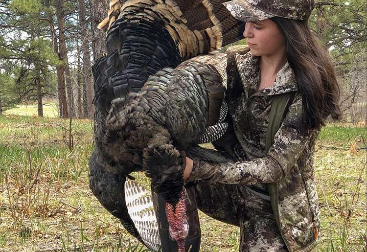 Female-campfire-collective-turkey-hunter-after-successful-hunt